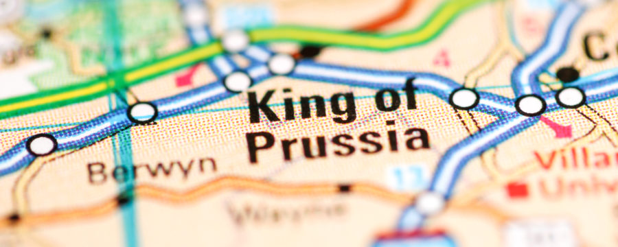 King of Prussia, Pennsylvania on a colorful old-fashioned highway map in bold. Blurred out on top and bottom.